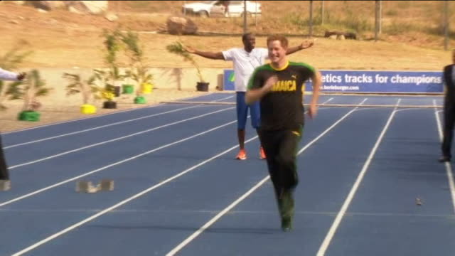 olympic star ryan lochte talks of meeting prince harry in las vegas r06031203 prince harry and sprinter usain bolt at track as prince harry distracts... - bolt stock videos & royalty-free footage