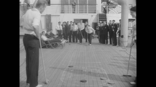 US Olympic team including Jesse Owens and Glenn Cunningham travels to Germany aboard the SS Manhattan
