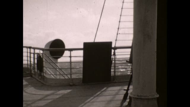 RMS Olympic the White Star Line Sister ship to the RMS Titanic / A right to left pan of 'B' Deck with a man walking past the camera The layout of...