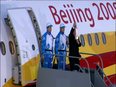 olympic torch arrives with delegates on plane from beijing - 2012年ロンドン夏季オリンピック点の映像素材/bロール