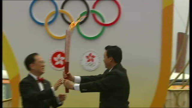Olympic torch relay reaches Hong Kong CHINA Hong Kong EXT Olympic flame handed to Donald Tsang