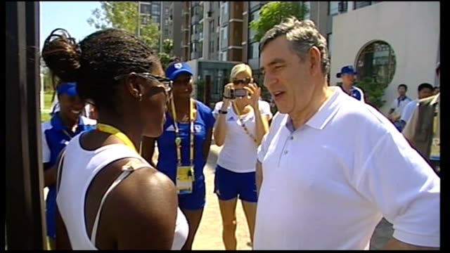 ext gordon brown speaking with british athlete christine ohuruogu who won the gold medal in 400m race sot we're really proud of you back home... - shirt and tie stock videos & royalty-free footage