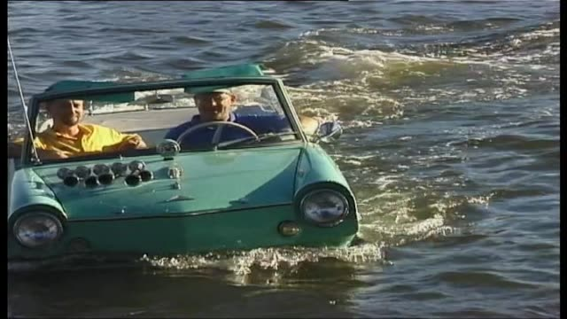 olympicar drives in water - amphibious vehicle stock videos & royalty-free footage