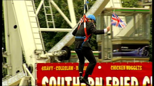 olympics and paralympics athletes' parade 2012 boris johnson speech 182012 victoria park ext boris along on zip wire waving union jack flags low... - victoria park london stock videos & royalty-free footage