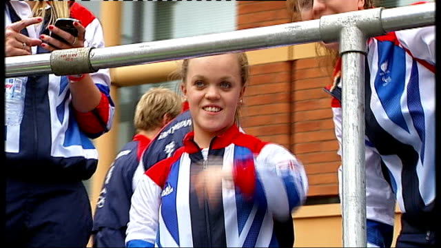 olympics and paralympics athletes' parade 2012 ellie simmonds waving from float - parade float stock videos and b-roll footage
