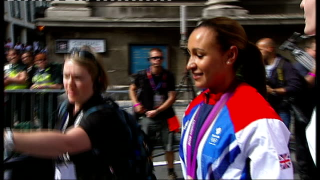 Olympics and Paralympics Athletes' Parade 2012 ENGLAND London EXT Jessica Ennis along towards float at start of parade Jessica Ennis signing...