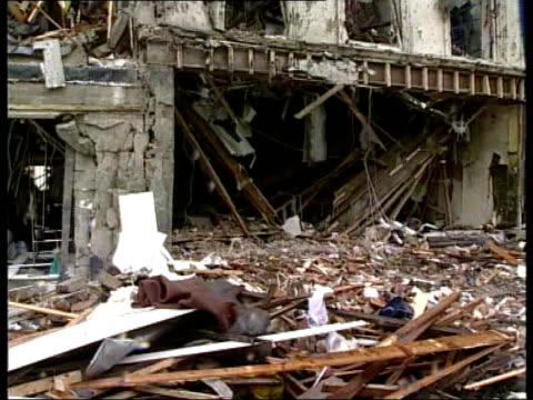 omagh: ext gv bomb damaged building following real ira attack bombed shops with cordon across street in f/g debris and rubble outside shop bomb... - roped off stock videos & royalty-free footage
