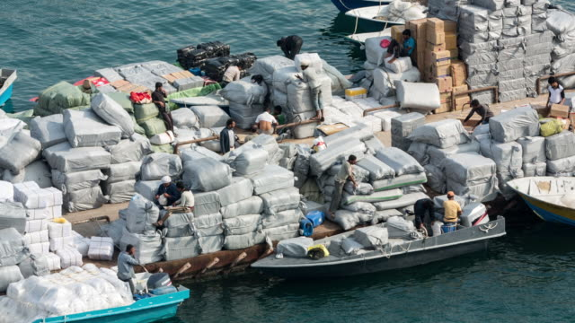 Oman, Khasab, Harbour, Iranian smugglers bringing sheep and agricultural products to Oman and luxury goods back to Iran with small boats, passing the Strait of Hormuz