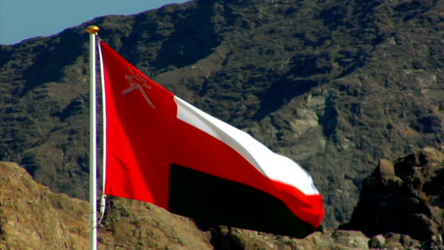 mcu omani flag blowing in wind / muscat, oman - oman flag stock videos and b-roll footage