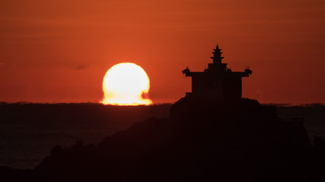 omega sunrise of orangdae park / gijang-gun, busan, south korea - pagoda stock videos & royalty-free footage