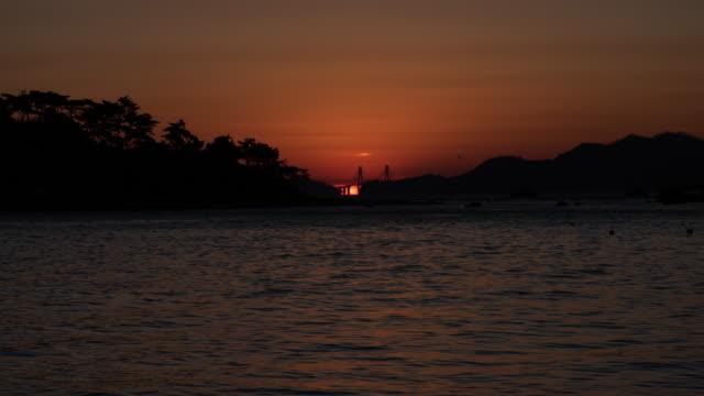 omega sunrise of orangdae park / gijang-gun, busan, south korea - omega sun mirage stock videos & royalty-free footage