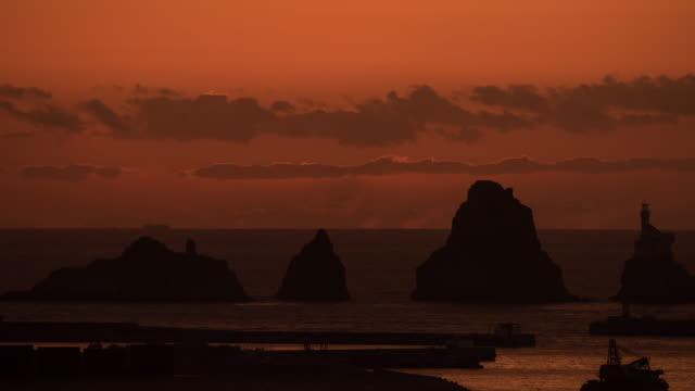 omega sunrise over fishing vessels and olyugdo island / nam-gu, busan, south korea - omega sun mirage stock videos & royalty-free footage