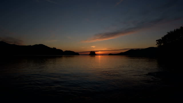 omega sunrise over solseom island / namhae-gun, gyeongsangnam-do, south korea - omega sun mirage stock videos & royalty-free footage
