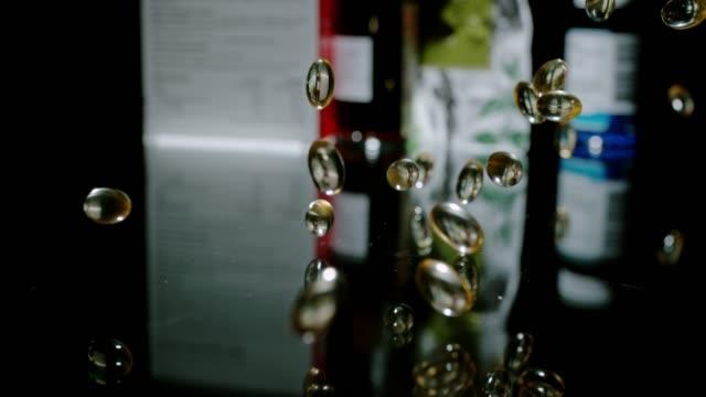 slo mo omega-3 capsules vs vs traditional medicine - omega 3 stock videos & royalty-free footage