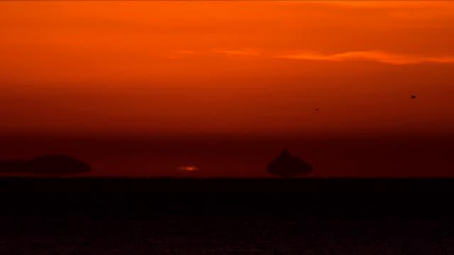 omega-shaped sunrise / namhae-gun, gyeongsangnam-do, south korea - omega sun mirage stock videos & royalty-free footage