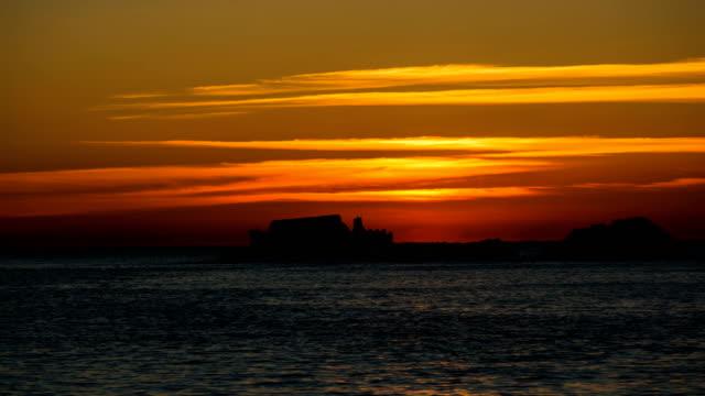 omega-shaped sunrise over mojaseom island (gyeongdo island) in dadaepo beach / saha-gu, busan, south korea - omega sun mirage stock videos & royalty-free footage