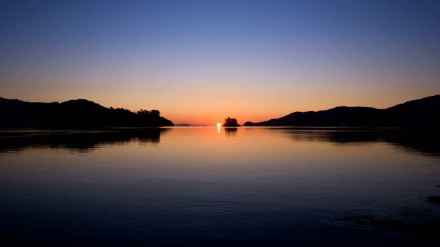 omega-shaped sunrise over solseom island / namhae-gun, gyeongsangnam-do, south korea - omega sun mirage stock videos & royalty-free footage