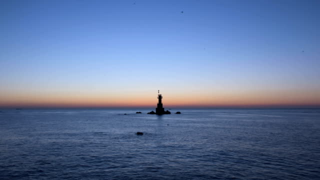 omega-shaped sunrise over the songdaemal lighthouse / gyeongju-si, gyeongsangbuk-do, south korea - omega sun mirage stock videos & royalty-free footage