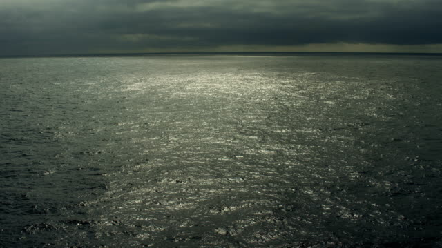 ominous seascape with dark clouds over north pacific ocean - north pacific ocean stock videos & royalty-free footage