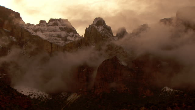 ominous storm clouds over the towers of the virgin and the sundial at zion national park - zion national park stock videos & royalty-free footage