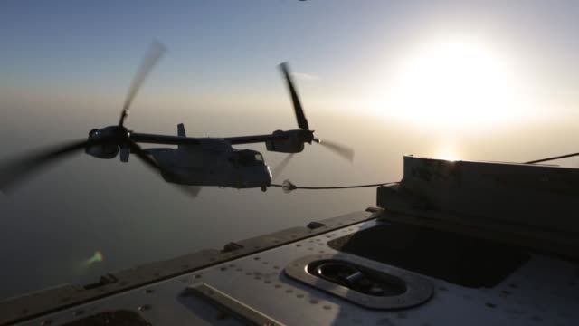 on 19 june 2014 the air combat elements attached to special purpose marine airground task force crisis response and conducts as flyby over the uss... - osprey stock videos & royalty-free footage
