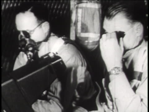 on a c-54 flight surgeon volunteers don goggles to test their visual reaction to an atomic blast; an atom bomb explodes during the flight surgeon's eye test. - nuclear weapon stock videos & royalty-free footage
