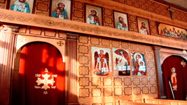 on a church iconostasis decorated with icons of saints, including john the baptist. - baptist stock videos & royalty-free footage