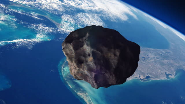 asteroid on a collision course with planet earth. - hitting stock videos & royalty-free footage