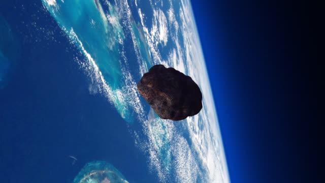 惑星地球との衝突コース上の小惑星。 - 小惑星点の映像素材/bロール