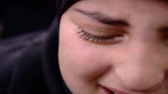 vídeos y material grabado en eventos de stock de on a crying shiite woman's face during ashura, which is a mourning rite commemorating the death of hussain ibn ali at the battle of karbala. - ashura