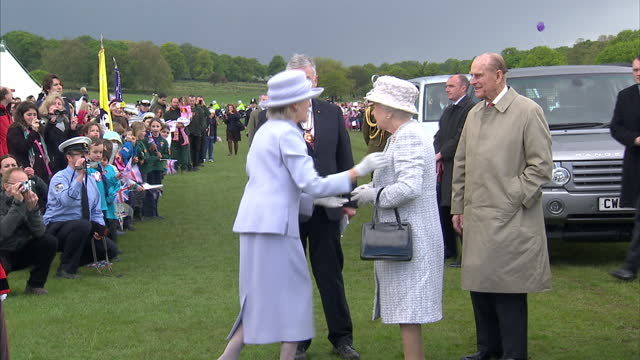 on a diamond jubilee visit to richmond upon thames the queen and duke of edinburgh arrive in richmond park exterior shots of hm queen elizabeth ii... - richmond upon thames stock-videos und b-roll-filmmaterial