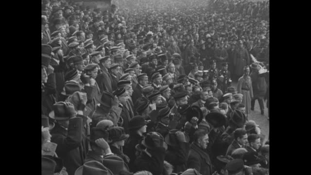 on a dreary wintery day a large crowd of germans outside the reichstag protests the occupation of the ruhr district by france and belgium / men in... - ruhr stock videos & royalty-free footage