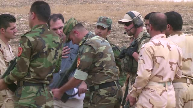 on a dusty firing range outside the iraqi kurdish capital of arbil peshmerga fighter ardalan aziz hamad and 19 others are the first to be trained to... - kurdischer abstammung stock-videos und b-roll-filmmaterial