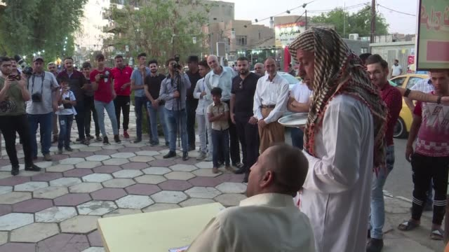 On a strip of pavement in the southern Iraqi city of Kut a gaggle of amateur comedians pulls in the crowds every Friday drawing chuckles smiles and...