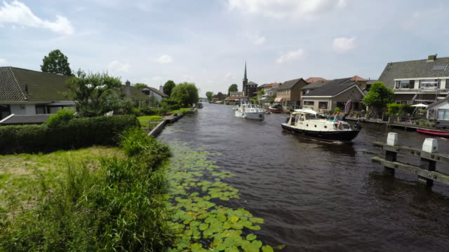 stockvideo's en b-roll-footage met on a summer day  in the green heart of the netherlands - nautical vessel