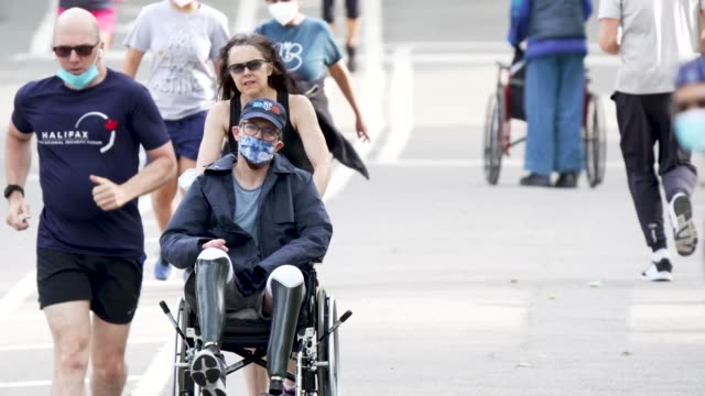 on a sunny day people exercising in manhattan's central park amid the outbreak of the coronavirus disease some wore a protective face mask and... - wheelchair stock videos & royalty-free footage