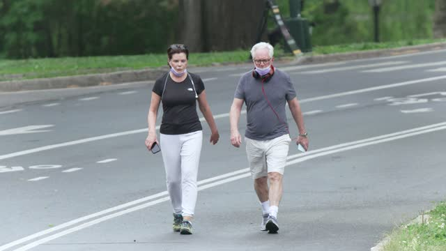 on a sunny day people exercising in manhattan's central park amid the outbreak of the coronavirus disease on may 22, 2020. some wore a protective... - active lifestyle stock videos & royalty-free footage