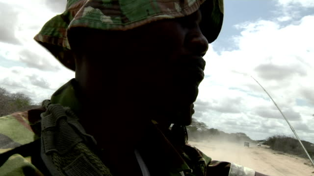 on a truck riding through the savanna Kenyan soldier carrying gun on July 31 2011 in Kenyan/Somali border Kenya