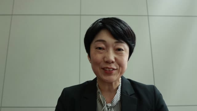 on a video conference with asian mid-adult woman - mature women stock videos & royalty-free footage