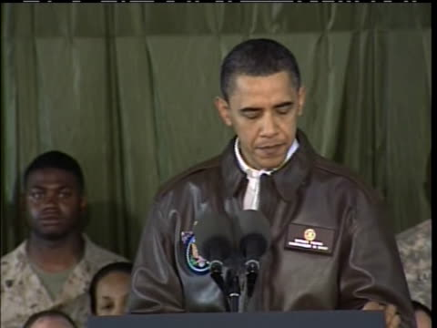 on a visit to afghanistan, president obama reminds american troops that they are there to end the reign of al qaeda and the taliban in that country. - (war or terrorism or election or government or illness or news event or speech or politics or politician or conflict or military or extreme weather or business or economy) and not usa stock videos & royalty-free footage