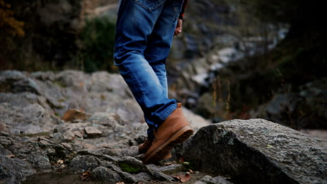 on a walk. hiker walking in a forest. - jeans stock videos & royalty-free footage