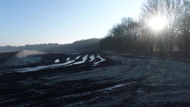 on a winter day in east anglia. ice has formed in tractor tracks. - east anglia stock videos & royalty-free footage