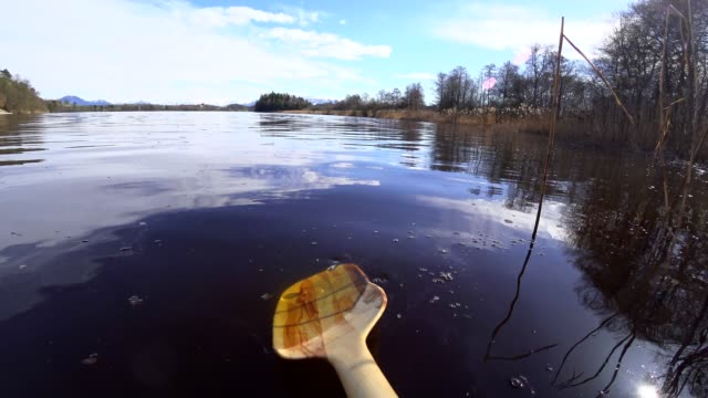 pov: on a wooden canoe in springtime - lakeshore stock videos & royalty-free footage