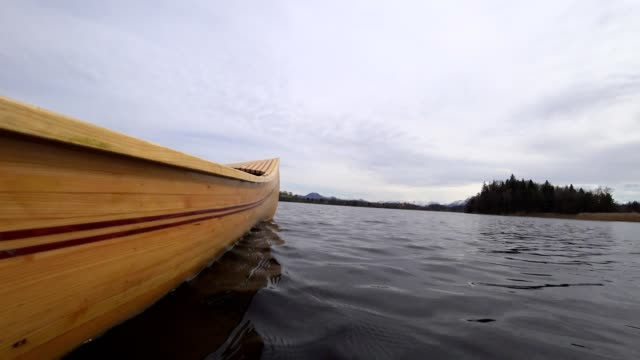 POV: on a wooden canoe in springtime