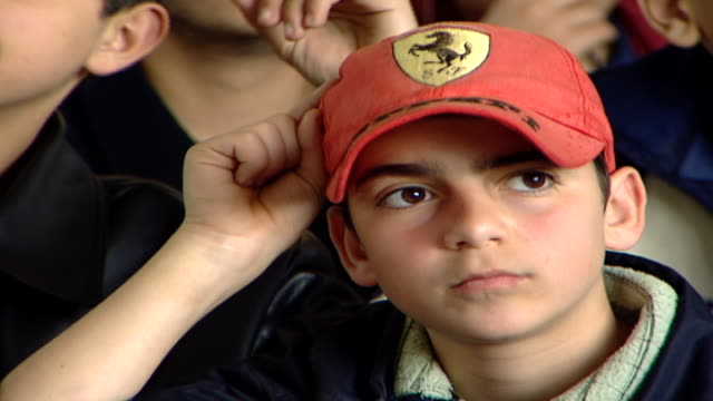 cu on a young boy's face wearing a red baseball cap with hand raised irfan is a druze religious school with five branches in lebanon that operate as... - red cap stock videos & royalty-free footage