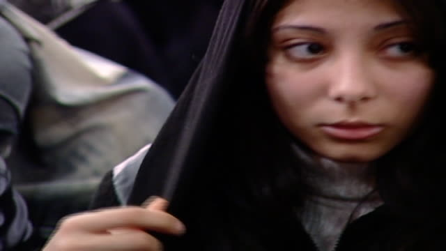 cu on a young pretty shiite girl during ashura which is a mourning rite commemorating the death of hussain ibn ali women are segregated from men in... - religiöse kleidung stock-videos und b-roll-filmmaterial
