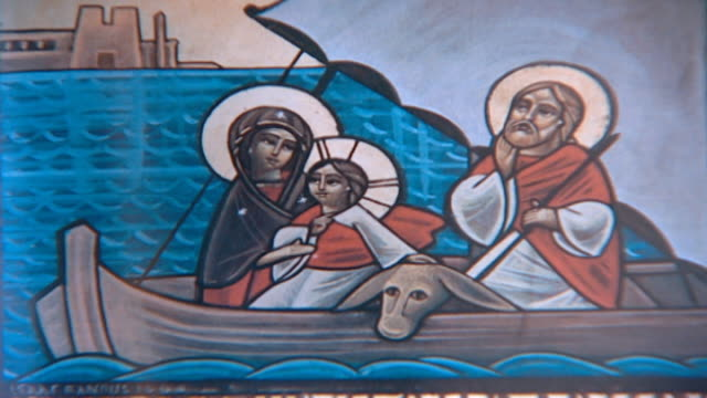 on an icon of the holy family in a felucca sailing up the nile in their journey to egypt. in the orthodox church, an icon is a sacred image, a window... - journey stock videos & royalty-free footage