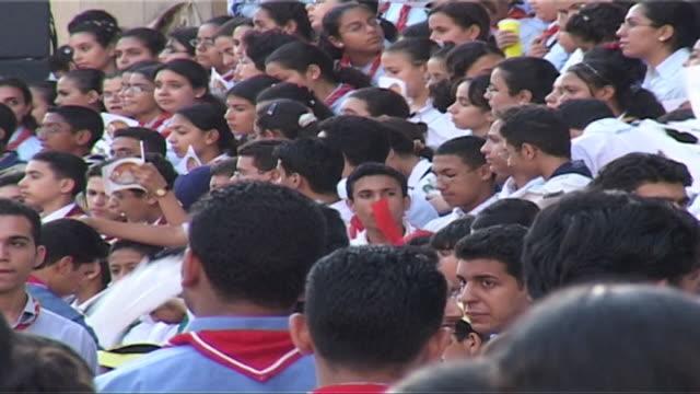 vídeos de stock, filmes e b-roll de on assembled pupils celebrating during st. mark's festival. - liga esportiva