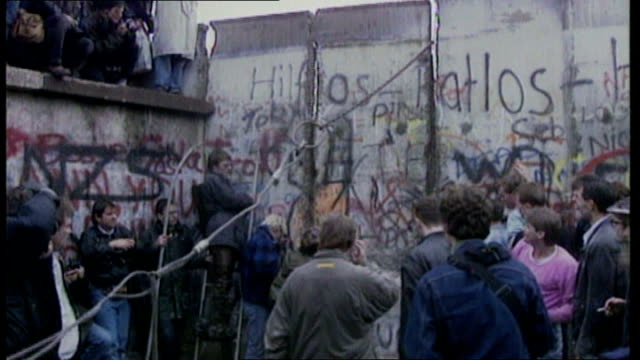 memories of a divided berlin and reunification bsp111189005 / germany west berlin ext slow motion man hitting the berlin wall with a hammer slow... - hammer stock videos and b-roll footage