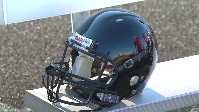 on aug. 20, 2014 at bolingbrook high school in bolingbrook, ill. - アメリカンフットボールヘルメット点の映像素材/bロール
